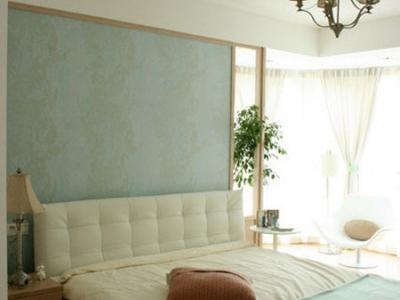 卧室很清爽,床头的那个设计很软