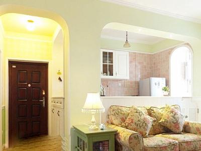 门厅的部分,一进门就是鞋柜。图上右手边是厨房,就在沙发的后面,用矮墙分隔开厨房,客厅和门厅三个空间。