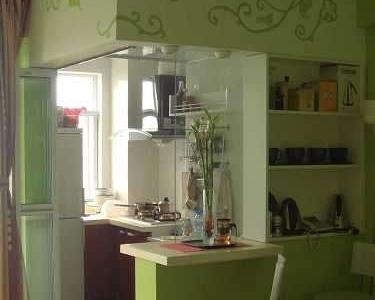 这里是我最得意的设计了 本来是半截墙半截窗的厨房隔断,打掉,做了一个吧台和一个搁架 吧台就是平时和老公2人餐桌的地方,呵呵,搬进来还没做过饭了